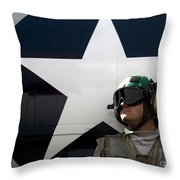 An Airman Stands In Front Of A C-2a Throw Pillow