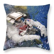 An Astronaut Is Submerged In The Water Throw Pillow by Stocktrek Images