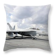An Ea-18g Growler Takes Off From Uss Throw Pillow