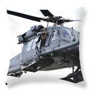 An Hh-60g Pavehawk Helicopter In Flight Throw Pillow