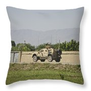 An M-atv Driving Towards Aliabad Throw Pillow