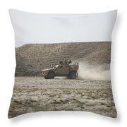 An M-atv Races Across The Wadi Throw Pillow