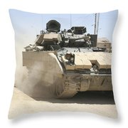 An M2 Bradley Fighting Vehicle Patrols Throw Pillow