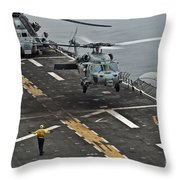 An Mh-60s Sea Hawk Lands Aboard Throw Pillow