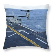 An Mv-22 Osprey Lands Aboard Throw Pillow