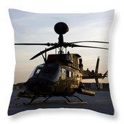 An Oh-58d Kiowa During Sunset Throw Pillow