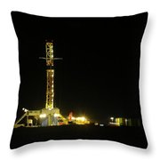 An Oil Rig At Night Throw Pillow