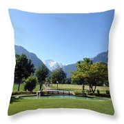 An Open Field In Interlaken With A View Of The Mountains In The Background Throw Pillow
