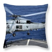 An Sh-60b Seahawk Helicopter Performs Throw Pillow
