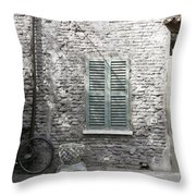Bicycle Leaning Against A Stone House Throw Pillow