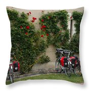 Bicycles Parked By The Wall Throw Pillow