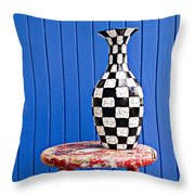 Blach And White Vase On Stool Against Blue Wall Throw Pillow