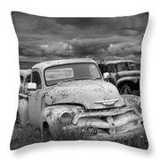Black And White Photograph Of A Junk Yard With Vintage Auto Bodies Throw Pillow