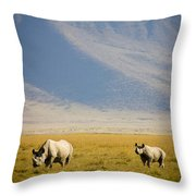 Black Rhinos Walking Across The Crater Throw Pillow