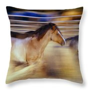 Blurred View Of Horses Running Through Throw Pillow