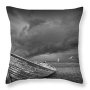 Boat Stranded On A Beach Covered By Menacing Storm Clouds Throw Pillow