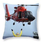 Boatswain Mate Directs A Hh-65a Dolphin Throw Pillow by Stocktrek Images