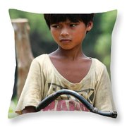 Boy On A Bike Throw Pillow