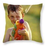 Boy Spraying Water Gun Throw Pillow