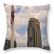 Buildings And Flags Against Sky Throw Pillow