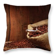 Burlap Sack Of Coffee Beans Against Dark Wood Throw Pillow by Sandra Cunningham