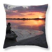Canoe At Sunset Throw Pillow
