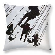 Carnival Goers Enjoy A Ride At An Throw Pillow