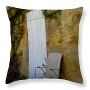 Chair By The White Door Throw Pillow