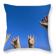 Childrens Hands Reach Toward The Blue Throw Pillow