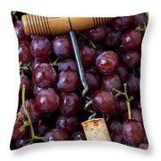 Corkscrew And Wine Cork On Red Grapes Throw Pillow by Garry Gay