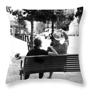 Couple Resting On A Downtown Bench On A Windy Day Throw Pillow