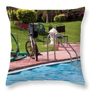 Cycle Near A Swimming Pool And Greenery Throw Pillow