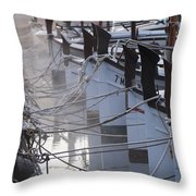 december's cold morning - A foggy day in port mahon with a line of traditional llaut boats  Throw Pillow