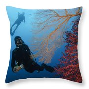 Divers Swimming By Sea Fans, Indonesia Throw Pillow