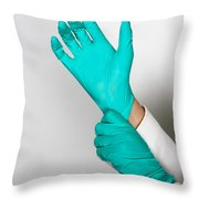 Doctor Putting On Gloves Throw Pillow