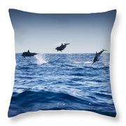Dolphins Playing In The Ocean Throw Pillow