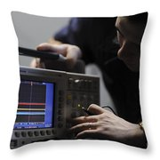 Electronics Technician Troubleshoots An Throw Pillow