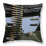 Expended Brass Falls From A Machine Gun Throw Pillow
