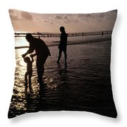 Families Play In A Shallow Lagoon Throw Pillow