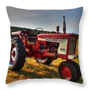 Farmall Tractor In The Sunlight Throw Pillow by Andrew Pacheco