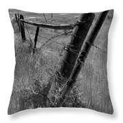 Fence Posts And Barbed Wire At The Edge Of A Field In Montana Throw Pillow