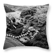 Fisherman Sleeping On A Huge Array Of Nets Throw Pillow