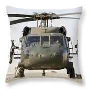 Front View Of A Uh-60l Black Hawk Throw Pillow by Terry Moore