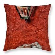 Gaslight On A Red Wall Throw Pillow