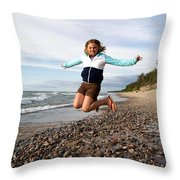 Girl Jumping At Lake Superior Shore Throw Pillow