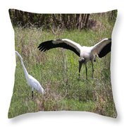 Great Egret And Wood Stork In The Marsh Throw Pillow