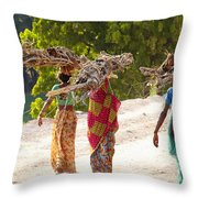 Group Of Women Carrying Firewood Near Throw Pillow