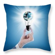 Hand Holding Light Bulb With Globe  Throw Pillow