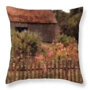 Hollyhocks And Thatched Roof Barn Throw Pillow