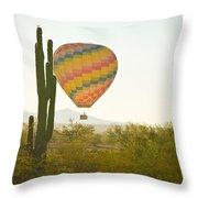 Hot Air Balloon Over The Arizona Desert With Giant Saguaro Cactu Throw Pillow
